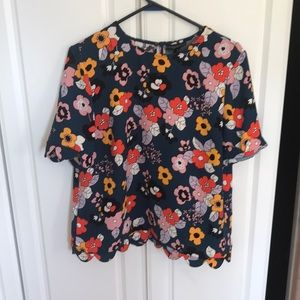 Flowered print top with scalloped edges.